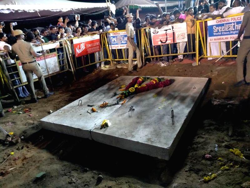 DMK patriarch and former Tamil Nadu Chief Minister M. Karunanidhi laid to rest on the Marina beachfront at Anna Memorial, in Chennai on Aug 8, 2018. Karunanidhi was buried beside his mentor ... - M. Karunanidhi
