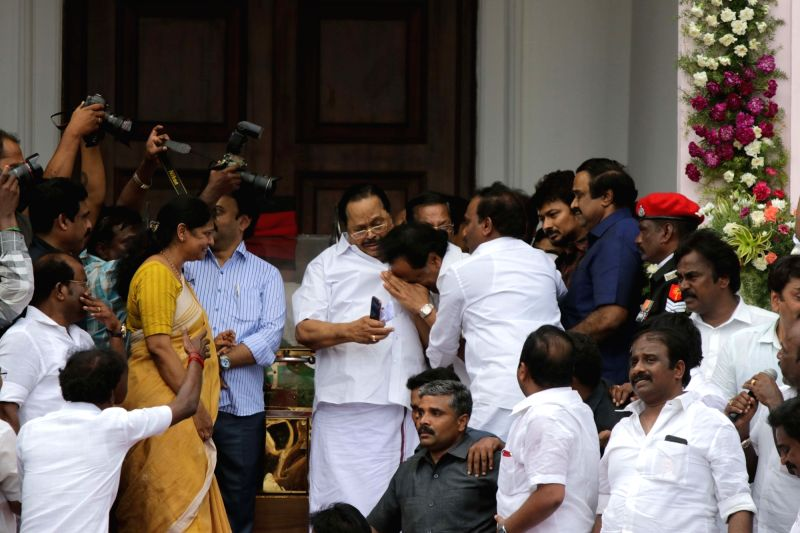 DMK  patriarch M. Karunanidhi's son M.K. Stalin broke down as his sister Kanimozhi and senior DMK leader Duraimurugan comforts him in front of the mortal remains of DMK patriarch M. ...