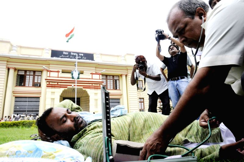 Doctors diagnose RJD legislator Dinesh Kumar Singh who is on indefinite fast to press for release of water into the canal system for irrigation and declaration of the state as drought-hit at Bihar ...