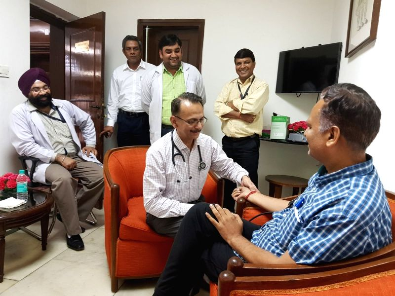 Doctors examine Delhi Health Minister Satyendra Jain who started an indefinite strike at Lt. Governor Anil Baijal's office in New Delhi, on June 11, 2018. - Satyendra Jain