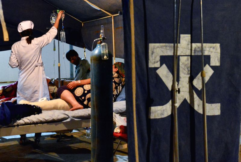 Doctors treat injured residents in a tent in Pishan County of Hotan Prefecture, northwest China's Xinjiang Uygur Autonomous Region, July 4, 2015. A 6.5-magnitude ...