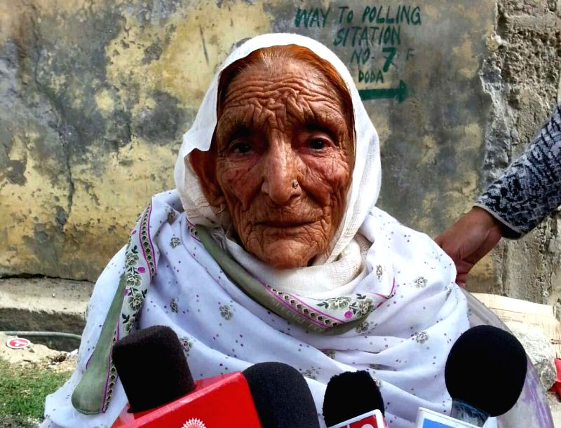 An old lady talks to press after casting her vote during the first phase of Jammu and Kashmir assembly polls in Bhaderwah of states' Doda district on Nov 25, 2014.