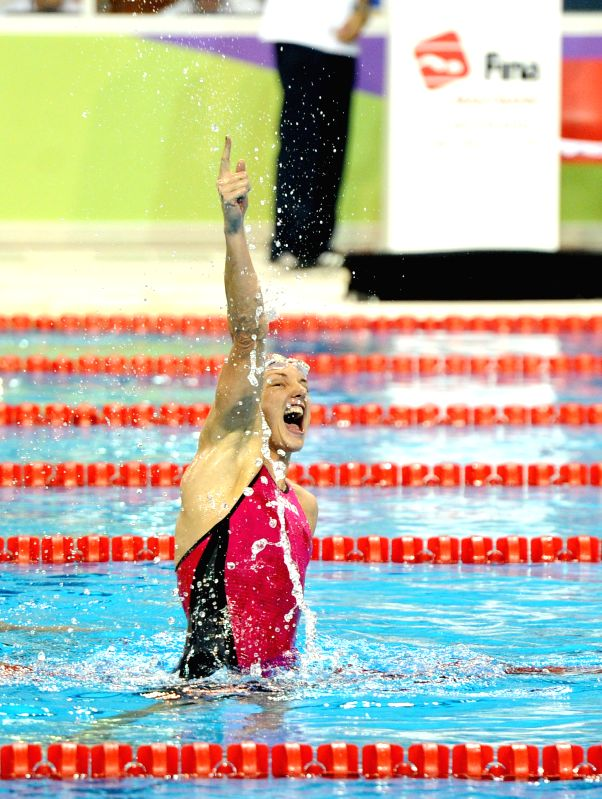Hungary's Katinka Hosszu celebrates after the women's 200m individual medley final at the 2014 FINA/MASTBANK Swimming World Cup in Doha, capital of Qatar, Aug. 27, ...
