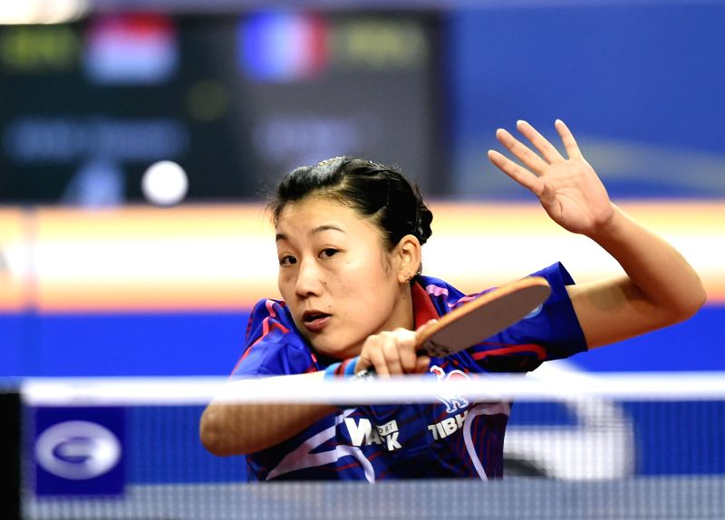 Li Xue of France returns the ball during the women's singles quarterfinal against Singapore's Feng Tianwei at the GAC Group 2015 ITTF World Tour, Qatar Open (Super), ...