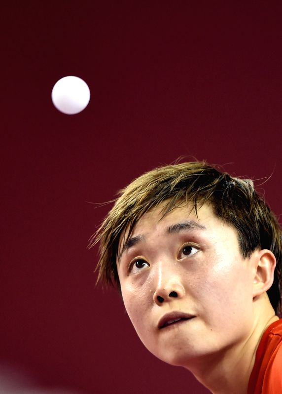 Singapore's Feng Tianwei serves the ball during the women's singles quarterfinal against Li Xue of France at the GAC Group 2015 ITTF World Tour, Qatar Open (Super), in ...