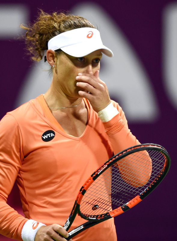 Samantha Stosur of Australia reacts during the first round match against Lucie Safarova of the Czech Republic in the WTA Qatar Open tennis tournament in Doha, Qatar, ...