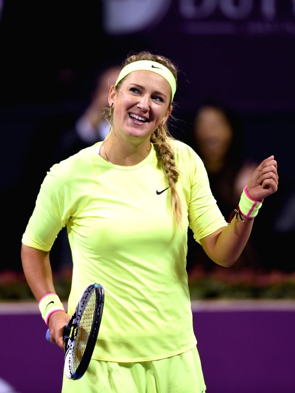 Victoria Azarenka of Belarus celebrates after the first round match against Angelique Kerber of Germany in the WTA Qatar Open tennis tournament in Doha, Qatar, Feb. ...