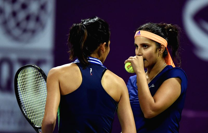 Indian tennis player Sania Mirza and Taiwanese player Hsieh Su-wei during a WTA Qatar Open women's doubles semi-finals match against Chinese Taipei player Chan Hao-Ching and Australian player ...
