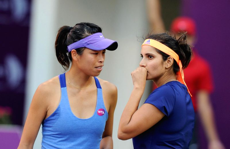 Indian tennis player Sania Mirza and Taiwanese player Hsieh Su-wei during the WTA Qatar Open women's doubles final against US players Raquel Kops-Jones and Abigail Spears in Doha, Qatar on ...