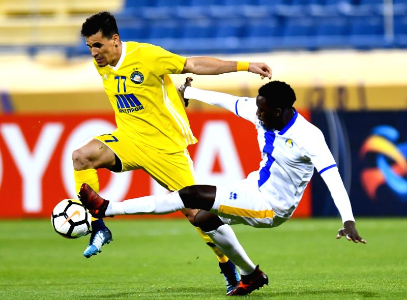 DOHA, Jan. 31, 2018 - Saeed Alhag Essa (R) of Qatar's Al-Gharafa vies with Tiago Queiroz of Uzbekistan's Pakhtakor during their AFC Champions League qualification match at Gharafa stadium in Doha, ...