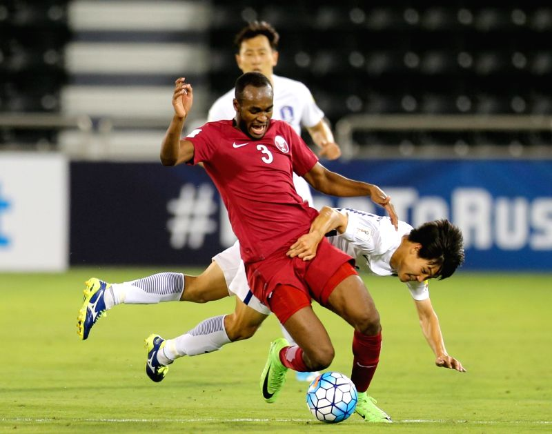 DOHA, June 14, 2017 - Choi Chul Soo (Bottom) of South Korea vies for the ball with Abdelkarim Hassan of Qatar during their 2018 FIFA World Cup qualification soccer match at the Jassim Bin Hamad ... - Abdelkarim Hassan