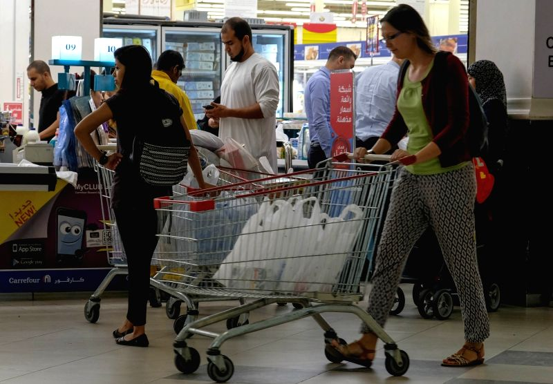 DOHA, June 6, 2017 - People buy food at a supermarket in Doha, capital of Qatar, on June 6, 2017. Bahrain, the United Arab Emirates and Yemen joined Saudi Arabia and Egypt in severing relations with ...