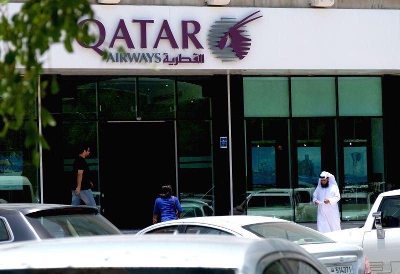 DOHA, June 6, 2017 - People walk past the Qatar Airways headquarters in Doha, capital of Qatar, on June 6, 2017. Bahrain, the United Arab Emirates and Yemen joined Saudi Arabia and Egypt in severing ...
