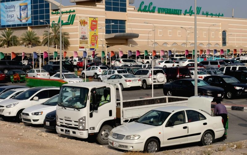 DOHA, June 6, 2017 - Vehicles are seen at a parking lot in front of Lulu Hypermarket in Doha, capital of Qatar, on June 6, 2017. Bahrain, the United Arab Emirates and Yemen joined Saudi Arabia and ...