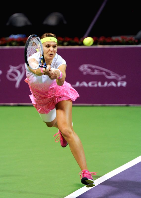 Lucie Safarova of the Czech Republic returns the ball to Victoria Azarenka of Belarus in the women's singles final of the Qatar Open tennis tournament in Doha on Feb. ...