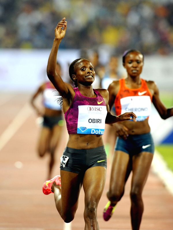 Hellen Obiri of Kenya celebrates after winning the women's 3000 Metres final at the IAAF Diamond League in Doha, capital of Qatar, May 9, 2014. Obiri claimed the title .