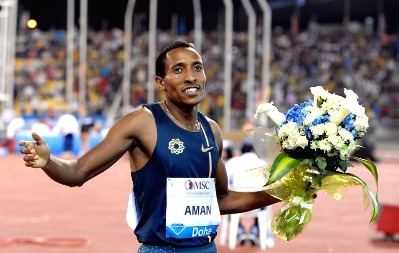 Mohammed Aman of Ethiopia celebrates his victory in the men's 800 Metres final at the IAAF Diamond League in Doha, capital of Qatar, May 9, 2014. Aman claimed the title