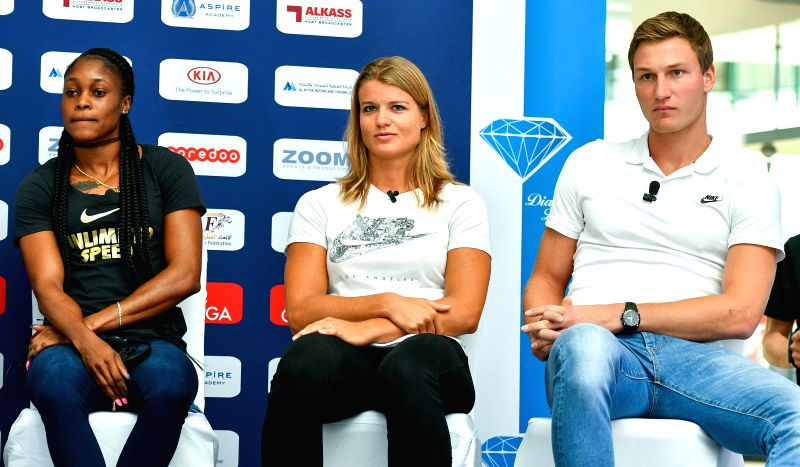 DOHA, May 4, 2017 - Elaine Thompson(L) of Jamaica, Dafne Schippers(C) of the Netherlands and Thomas Rohler of Germany attend a press conference for the 2017 IAAF Diamond League in Doha, capital of ...