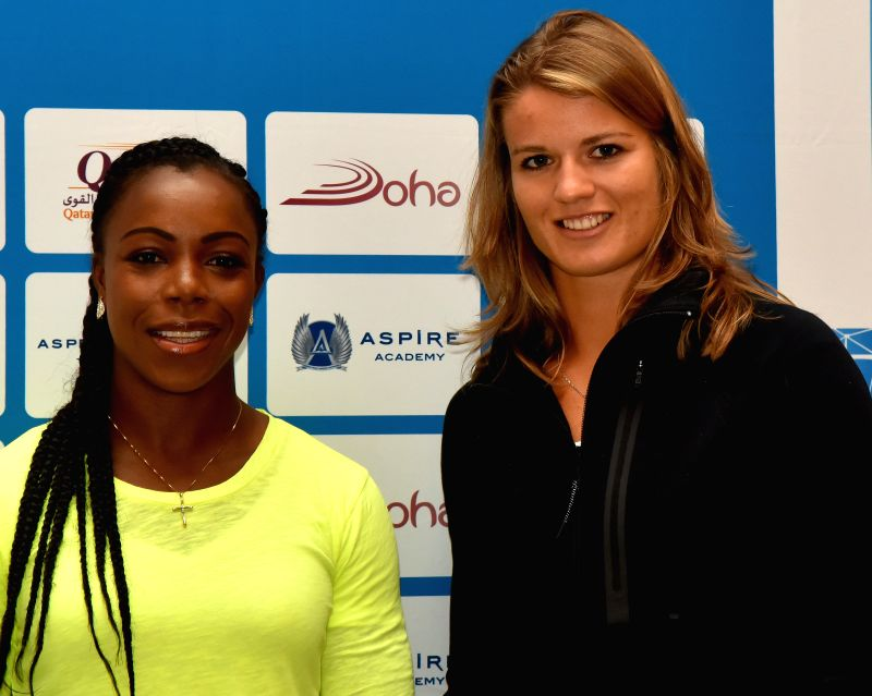 DOHA, May 5, 2016 - Jamaica's Veronica Campbell-Brown (L) and the Netherlands' Dafne Schippers pose for pictures after the press conference for the 2016 IAAF Diamond League in Doha, capital of Qatar, ... - Campbell