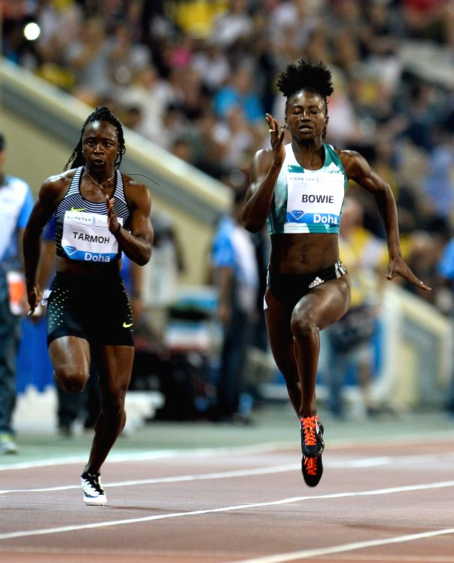 DOHA, May 7, 2016 - Jeneba Tarmoh (L) and Tori Bowie of the United States compete in the women's 100m race during the IAAF Diamond League in Doha, capital of Qatar, May 6, 2016. Tori Bowie claimed ...