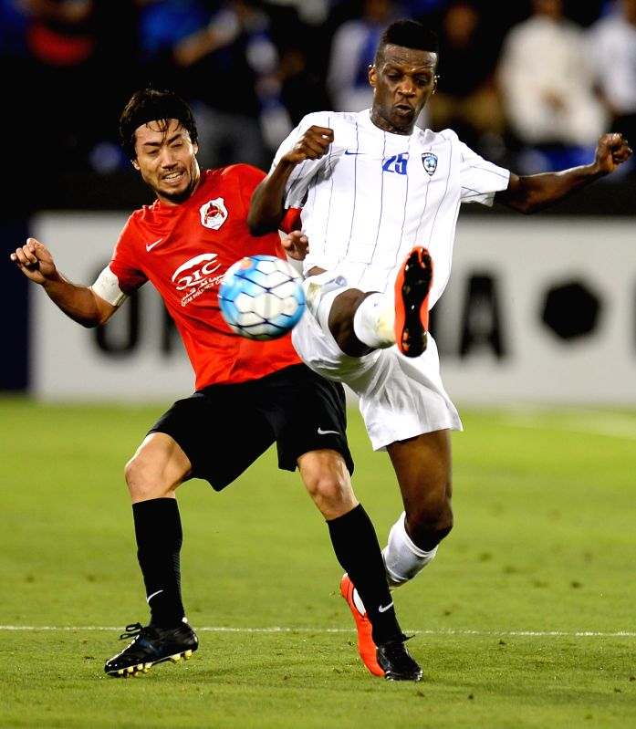 DOHA, May 9, 2017 - Faisal Darwish Faraj (R) of Al-Hilal vies with Rodrigo Tabata of AL Rayyan during the AFC Asian Champions League Group D match between Qatar's AL Rayyan and Saudi Arabia's Al ...