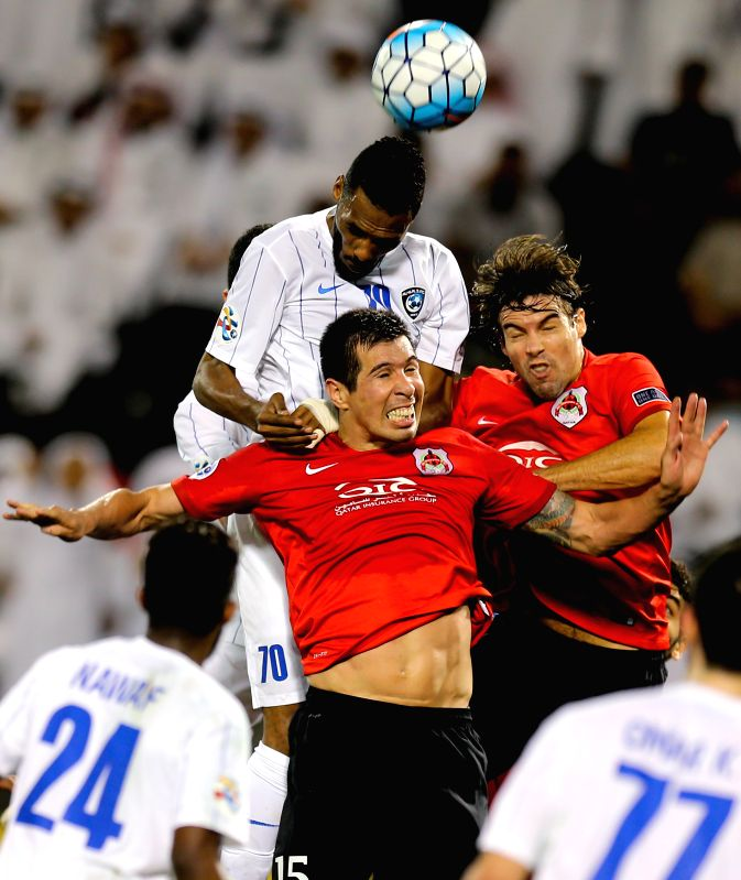 DOHA, May 9, 2017 - Mohammed Jahfali (Top) of Al-Hilal heads the ball during the AFC Asian Champions League Group D match between Qatar's AL Rayyan and Saudi Arabia's Al Hilal at Jassim Bin Hamad ...