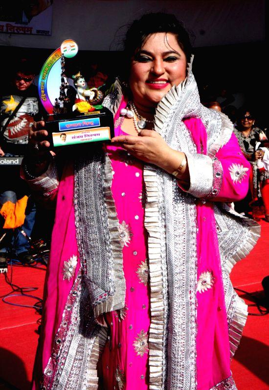 Dolly Bindra during Dahi Handi festival at Politician Sanjay Nirupam`s Dahi Handi in Mumbai on August 29, 2013.