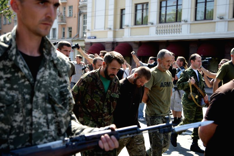 The prisoners walk through the street in Donetsk, Ukraine, on Aug. 24, 2014. Local militia in Donetsk held their own parade on the Independence Day of Ukraine. At ..