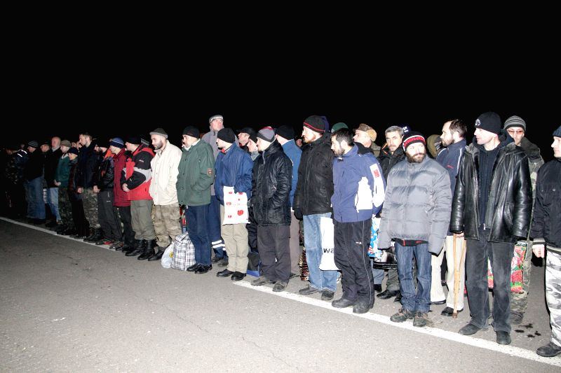 Ukrainians captured by the rebels wait during the exchange process of prisoners of war near Donetsk, eastern Ukraine, on Dec. 26, 2014. Ukrainian troops and ...