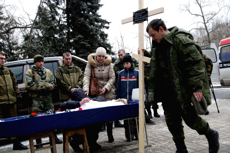 Relatives cry on funeral of two local militias, who was killed in fightings with Ukrainian troops near Debalcevo in Donetsk, Ukraine, on Feb. 16, 2015. Fighting ...