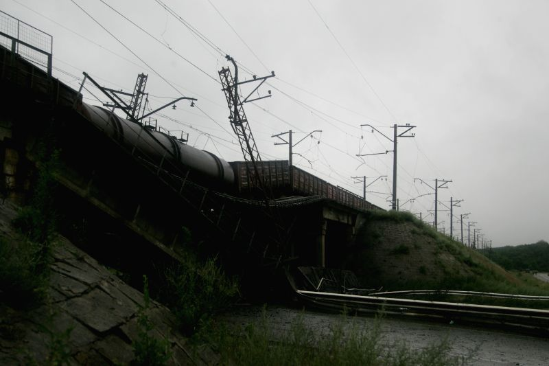 Photo taken on July 7, 2014 shows the collapsed bridge which leads to the city of Donetsk, Ukraine. Explosions destroyed three bridges to Donetsk on Monday. ...