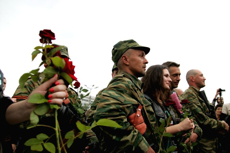 Photo taken on June 21, 2014 shows army recruits of the self-proclaimed Donetsk People's Republic in the central square of Donetsk, Ukraine. About 100 recruits will