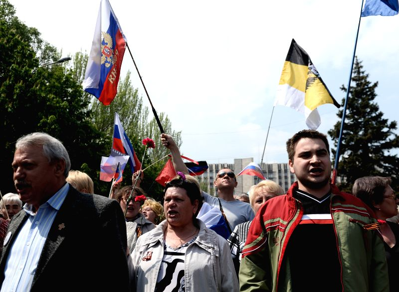Pro-Russia activists rally in front of the government building in central Donetsk, Ukraine, on May 1, 2014.