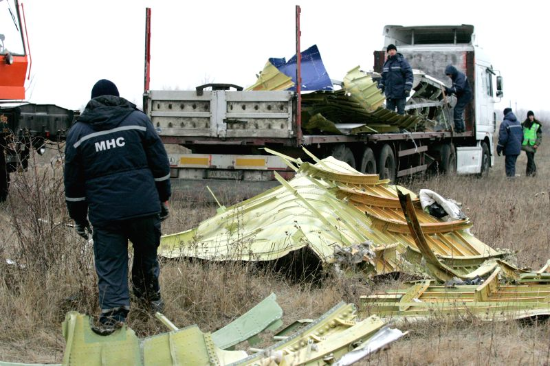 Donetsk (Ukraine) : Workers work on the site where the MH17 plane of Malaysia Airlines crashed, on the outskirts of Donetsk, eastern Ukraine, on Nov. 18, 2014. The recovery of the wreckage of flight .