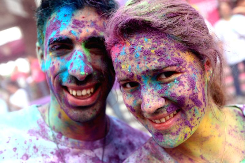 "Participants pose for photos during ""The Color Run"" in Dongguan, south China's Guangdong Province, April 12, 2014. The Color Run is a 5-kilometer, ..."