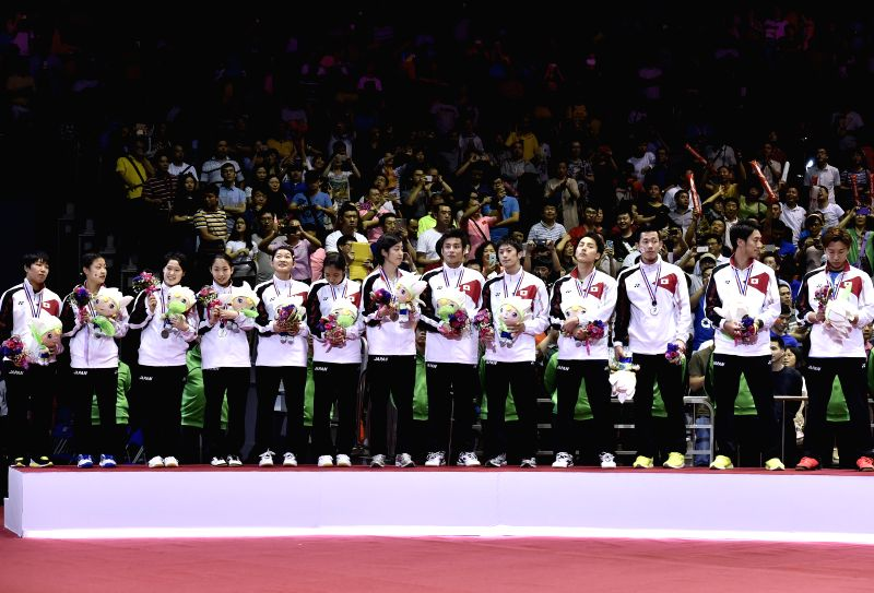 Silver medallists, Players of Japan celebrate during the awarding ceremony after the final of 2015 Sudirman Cup BWF World Mixed Team Championships in Dongguan, ...