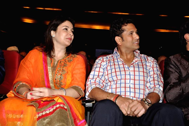 Dr Anjali Tendulkar and her husband Indian cricketer Sachin Tendulkar during a program to celebrate Sachin Pilgaonkar's 50 years in the Indian film industry in Mumbai on September 5, 2013. - Sachin Tendulkar