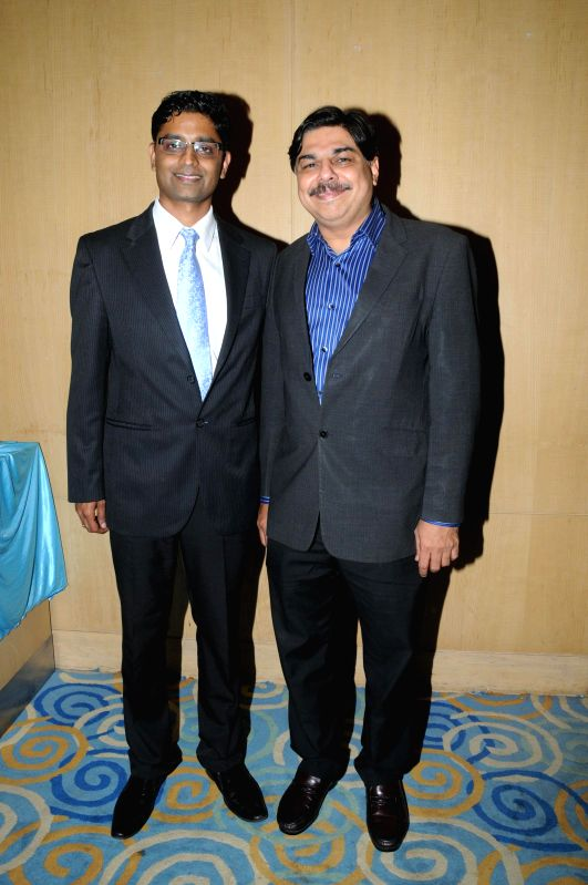 Dr. Hrishikesh Pai with Rajat Mehta during the press conference for the announcement of International Indian Achievers Awards (IIAA) trophy in Mumbai on July 21, 2014. - Rajat Mehta