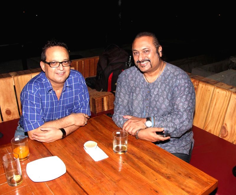 Dr. Mukul Dabholkar and Lesle Lewis during the launch of Rude Lounge`s Powai branch opening in Mumbai on June 14, 2014.