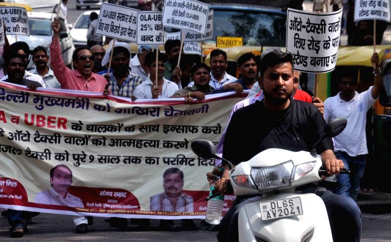 Drivers of app based taxis stage a demonstration outside Delhi Chief Minister Arvind Kejriwal's residence to press for their demands in New Delhi on April 18, 2017. - Arvind Kejriwal