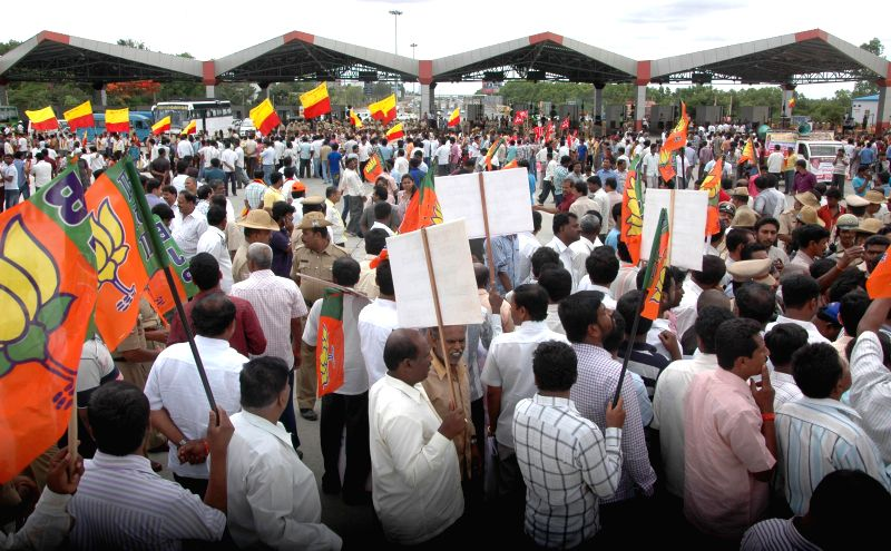 Drivers of taxi and buses demonstrate against hike in toll at Kempegowda International Airport in Bangalore on May 6, 2014.