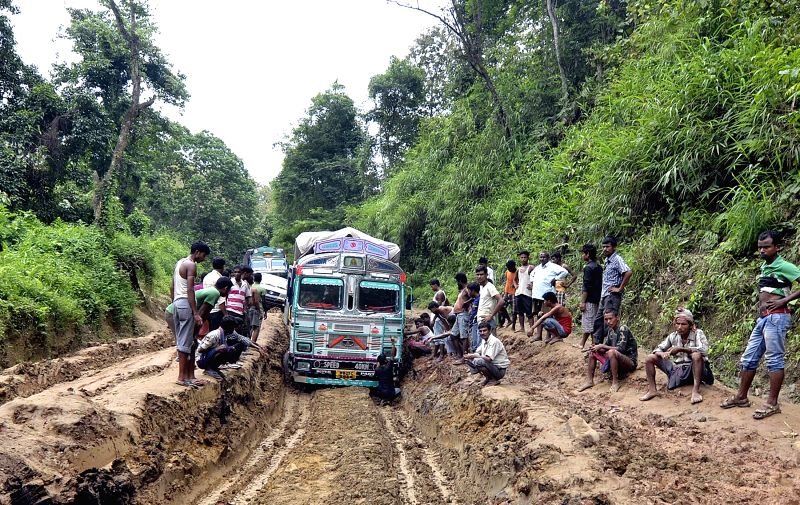 Drivers wait for opening of National Highway 44 as locals continue to block the highway for the fourth consecutive day to protest against its miserable condition between Churaibari in Tripura and ...