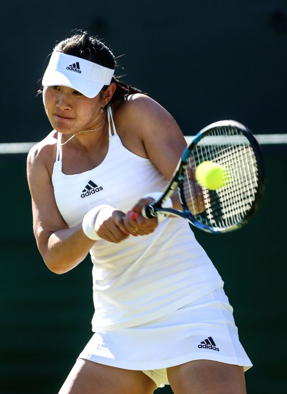 Duan Yingying of China hits a return to Eugenie Bouchard of Canada during the women's singles first round match at 2015 Wimbledon Tennis Championships in London, ...