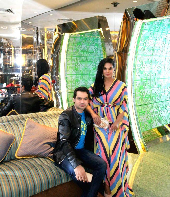 Actor Veena Malik celebrates her 31st birthday with husband Asad Bashir and son Abram at hotel Burj Al Arab in Dubai.
