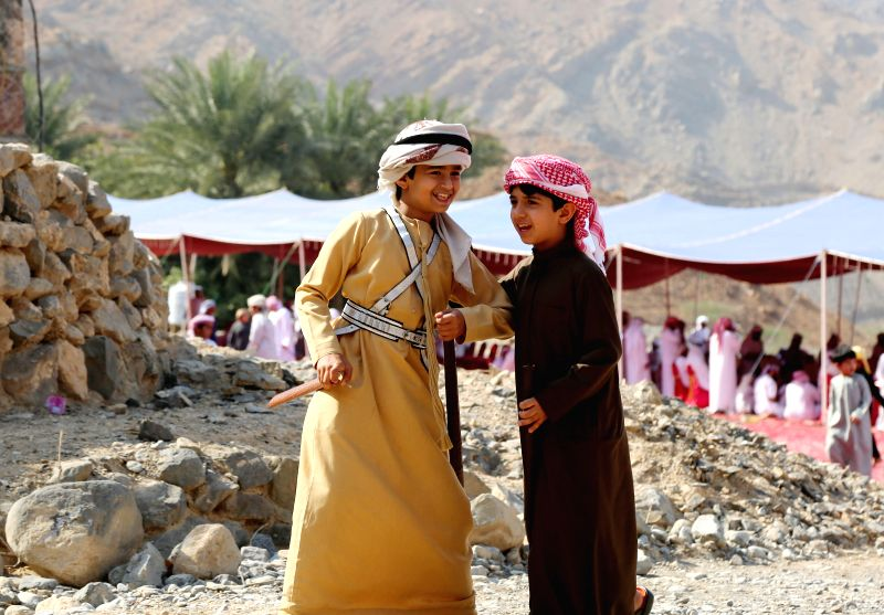 DUBAI, April 19, 2017 - Two boys play near the site of a traditional wedding ceremony on mountain Jebal Jais in Ras Al Khaimah, United Arab Emirates (UAE), March 10, 2017. The UAE, located at the ...