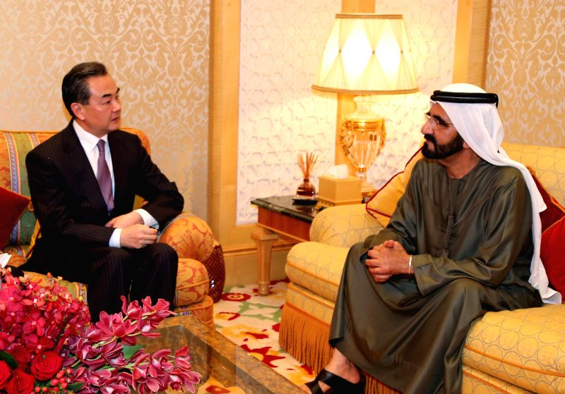 The United Arab Emirates (UAE) Vice President, Prime Minister and Dubai ruler Sheikh Mohammed Bin Rashid Al-Maktoum (R) meets with Chinese Foreign Minister Wang Yi in - Wang Y