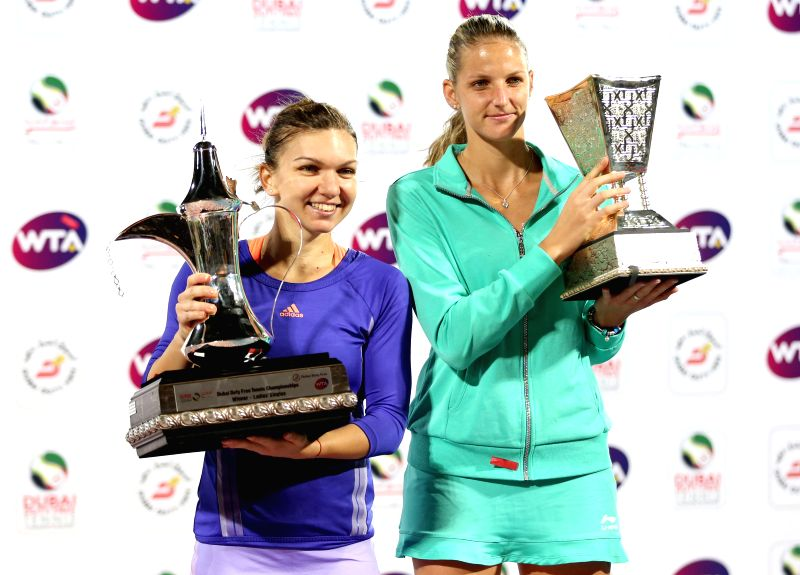 Simona Halep (L) of Romania and Karolina Pliskova of the Czech Republic pose with their trophies after the final of the WTA Dubai Duty Free Tennis Championships in ...