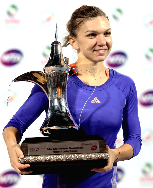 Simona Halep of Romania poses with her trophy after winning the final of the WTA Dubai Duty Free Tennis Championships in Dubai, the United Arab Emirates, Feb. 21, ...
