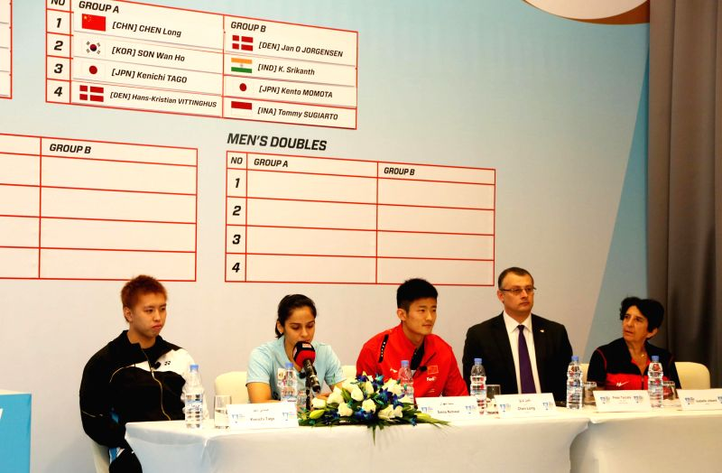 Indian badminton player Saina Nehwal and Chen Long of China with Secretary General of the Badminton World Federation Thomas Lund during the draw ceremony and press conference for the BWF ...