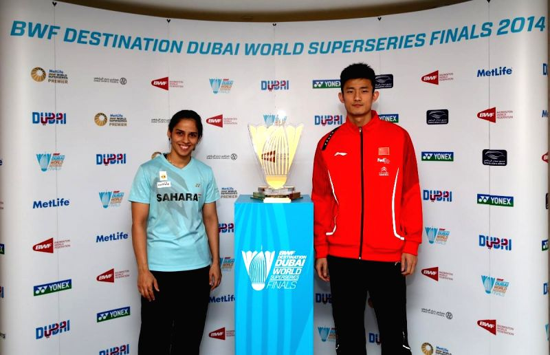 Indian badminton player Saina Nehwal and Chen Long of China pose with the BWF Destination Dubai World Super Series trophy after the draw ceremonyin Dubai, United Arab Emirates (UAE) on Dec 15,